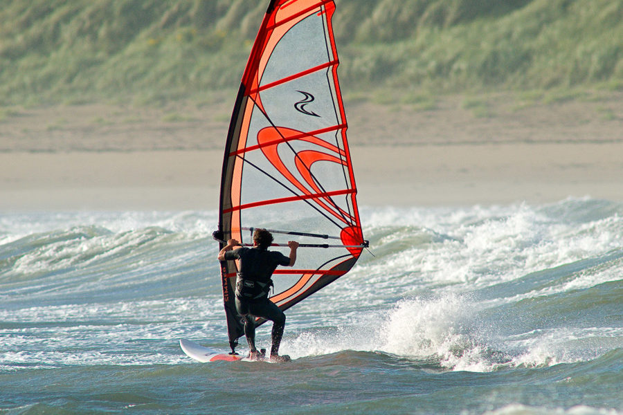 Windsurfing is one of the many outdoor activities that Snowdonia has to offer.